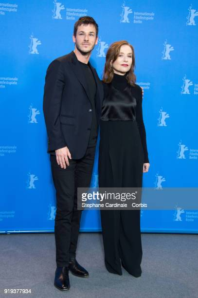 Actors Gaspard Ulliel and Isabelle Huppert pose at the 'Eva' photo call during the 68th Berlinale International Film Festival Berlin at Grand Hyatt...