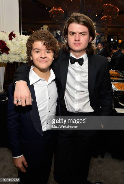Actors Gaten Matarazzo and Joe Keery attend the 2018 InStyle and Warner Bros 75th Annual Golden Globe Awards PostParty at The Beverly Hilton Hotel on...