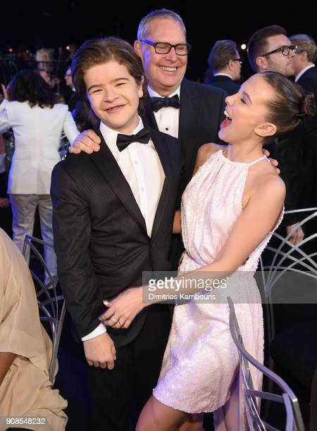 Actors Gaten Matarazzo and Millie Bobby Brown attend the 24th Annual Screen Actors Guild Awards at The Shrine Auditorium on January 21 2018 in Los...