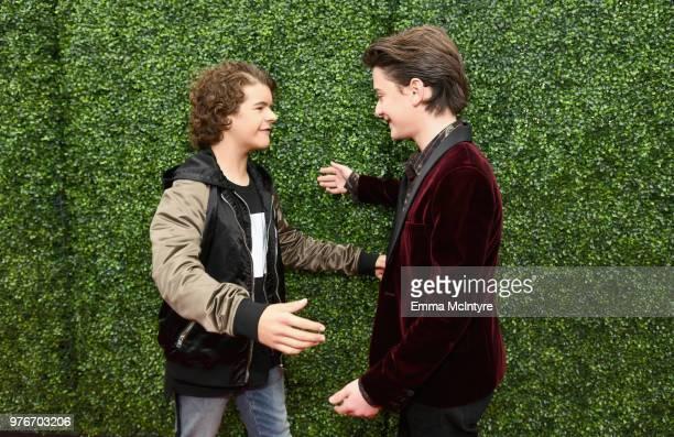 Actors Gaten Matarazzo and Noah Schnapp attends the 2018 MTV Movie And TV Awards at Barker Hangar on June 16 2018 in Santa Monica California