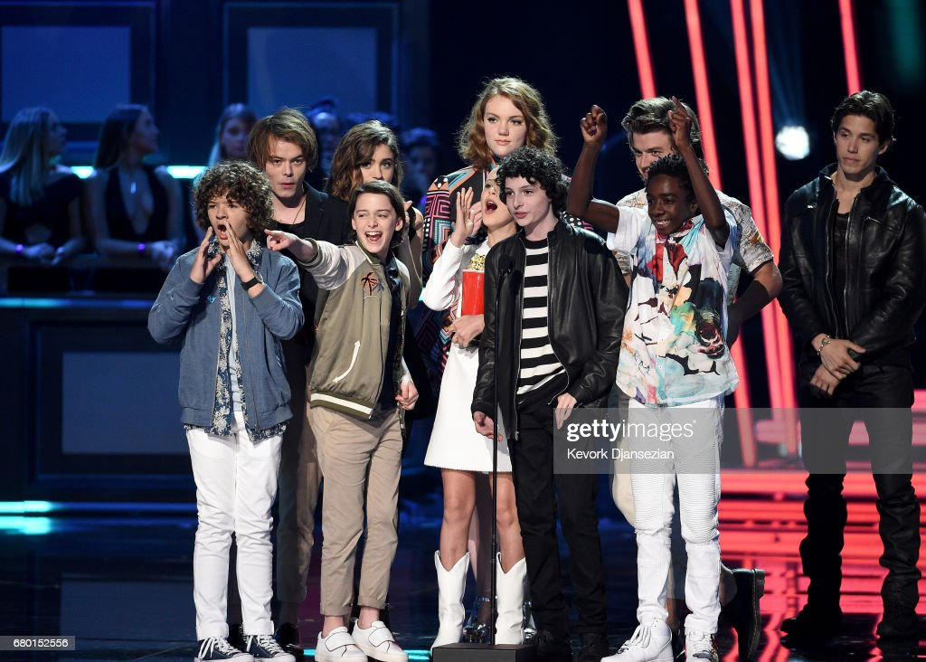 Actors Gaten Matarazzo, Charlie Heaton, Noah Schnapp, Natalia Dyer, Shannon Purser, Millie Bobby Brown, Finn Wolfhard, Joe Keery, and Caleb McLaughlin accept the award for Show of the Year onstage, during the 2017 MTV Movie And TV Awards at The Shrine Auditorium on May 7, 2017 in Los Angeles, California.