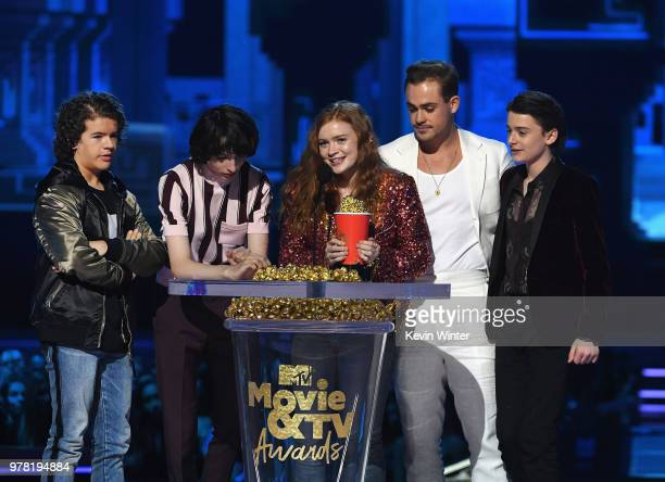 Actors Gaten Matarazzo Finn Wolfhard Sadie Sink Dacre Montgomery and Noah Schnapp accept the Best Show award for 'Stranger Things' onstage during the...