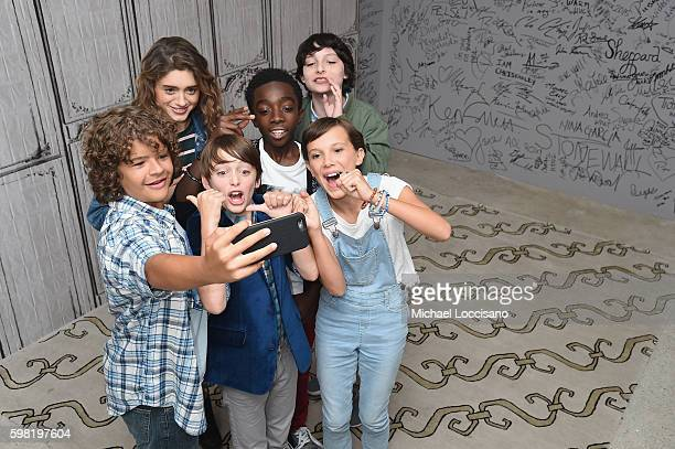 Actors Gaten Matarazzo Natalia Dyer Noah Schnapp Caleb McLaughlin Finn Wolfhard and Millie Bobby Brown of Stranger Things attend the BUILD Series at...