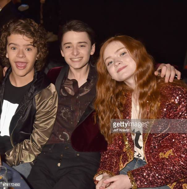 Actors Gaten Matarazzo Noah Schnapp and Sadie Sink attend the 2018 MTV Movie And TV Awards at Barker Hangar on June 16 2018 in Santa Monica California