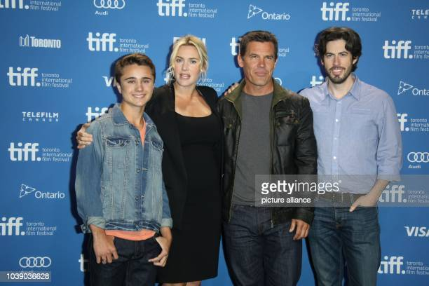 Actors Gattlin Griffith Kate Winslet Josh Brolin and Director Jason Reitman attend the photo call before the press conference of 'Labor Day' during...