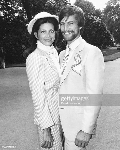 Actors Gayle Hunnicutt and Simon McCorkindale wearing their outfits for a celebrity fashion show at the Savoy Hotel London May 27th 1980