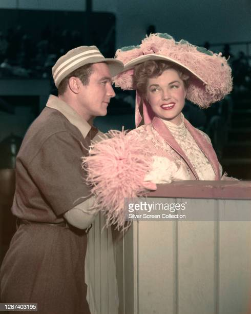 Actors Gene Kelly as baseball player Eddie O'Brien and Esther Williams as team owner KC Higgins in the musical comedy film 'Take Me Out to the Ball...