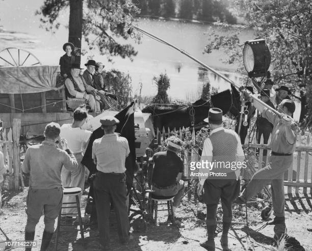 Actors Gene Reynolds Guy Kibbee Walter Huston and Beulah Bondi on a wagon in a scene from the MGM Civil War film 'Of Human Hearts' circa 1938