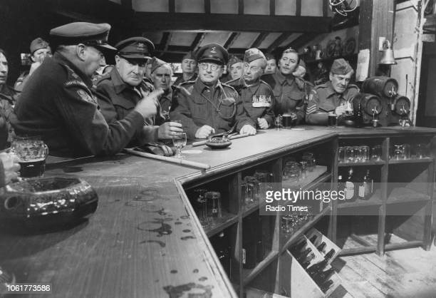 Actors Geoffrey Lumsden Robert Raglan John Laurie Arthur Lowe Clive Dunn James Beck and John Le Mesurier in a scene from episode 'Battle of the...
