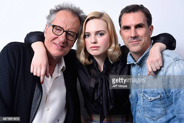 Actors Geoffrey Rush Odessa Young and Paul Schneider from 'The Daughter' pose for a portrait during the 2015 Toronto International Film Festival at...