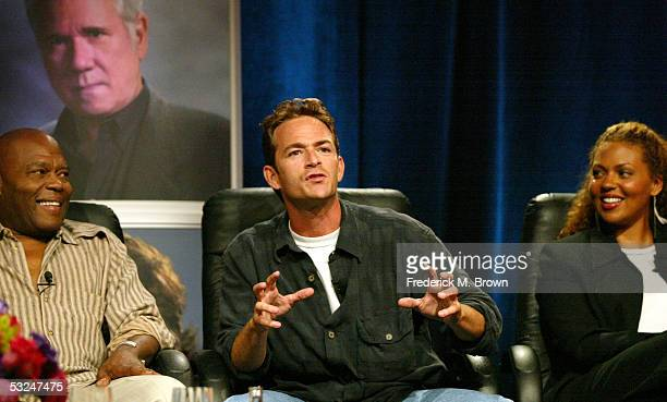 Actors Georg Stanford Brown Luke Perry and Kathryne Dora Brown attend the panel discussion during the Hallmark Channel presentation at the 2005...
