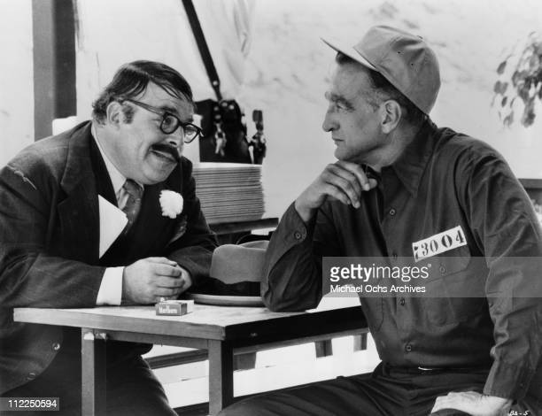 Actors George C. Scott and Sorrell Booke in a scene from the movie 'Bank Shot' in 1974.