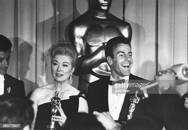 Actors George Chakiris Greer Garson and Maximilian Schell holding their Oscars at the 39th Academy Awards Los Angeles April 9th 1962