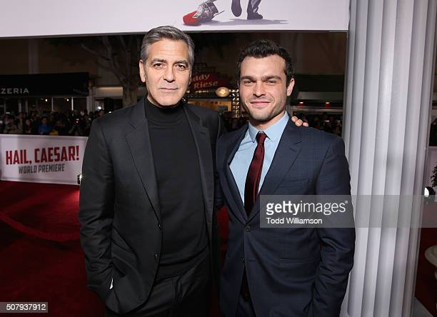 Actors George Clooney and Alden Ehrenreich attend Universal Pictures' 'Hail Caesar' premiere at Regency Village Theatre on February 1 2016 in...