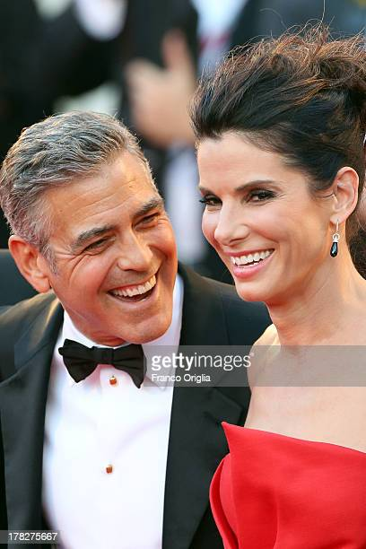 Actors George Clooney and Sandra Bullock attend the Opening Ceremony And 'Gravity' Premiere at Palazzo del Cinema on August 28 2013 in Venice Italy