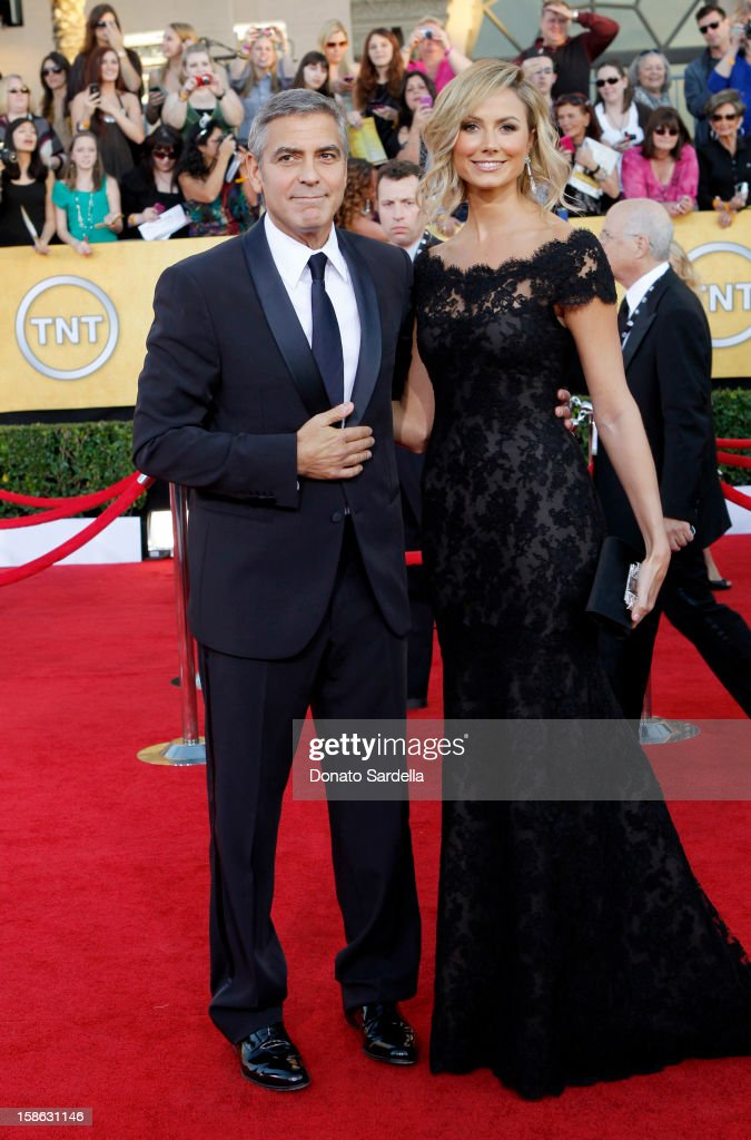 Actors George Clooney (L) and Stacy Keibler arrive at the 18th Annual Screen Actors Guild Awards held at The Shrine Auditorium on January 29, 2012 in Los Angeles, California.