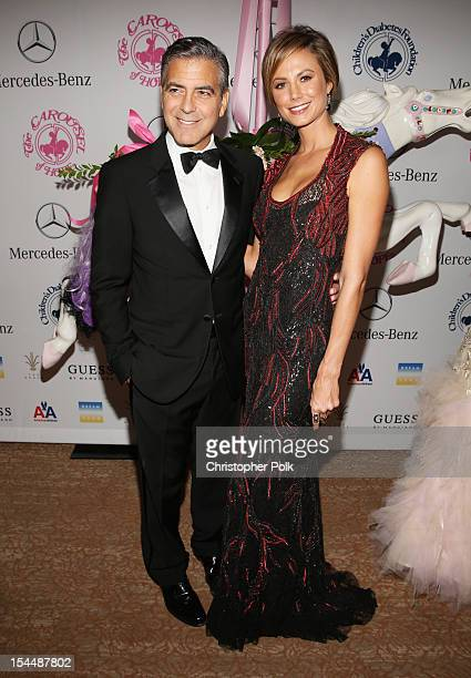 Actors George Clooney and Stacy Keibler attend the 26th Anniversary Carousel Of Hope Ball presented by MercedesBenz at The Beverly Hilton Hotel on...