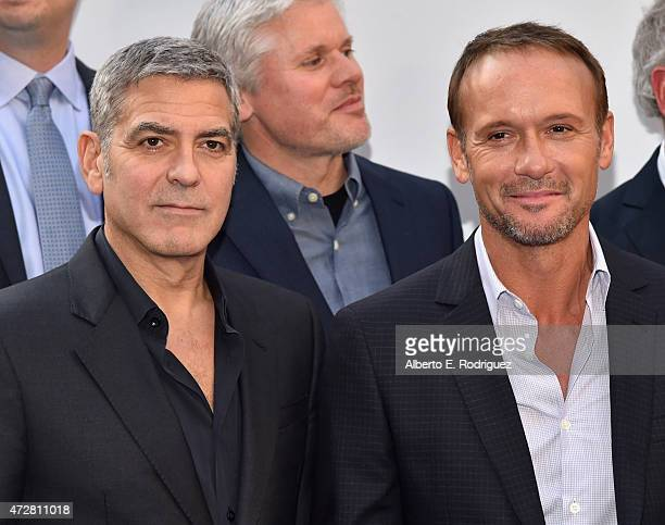 Actors George Clooney and Tim McGraw attend the world premiere of Disney's Tomorrowland at Disneyland Anaheim on May 9 2015 in Anaheim California