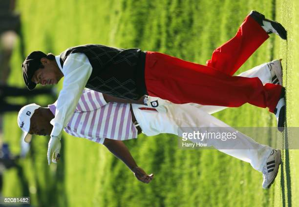 Actors George Lopez and Samuel L Jackson discuss a shot during the fourth round of the Bob Hope Classic at PGA West Palmer Course on January 29 2005...