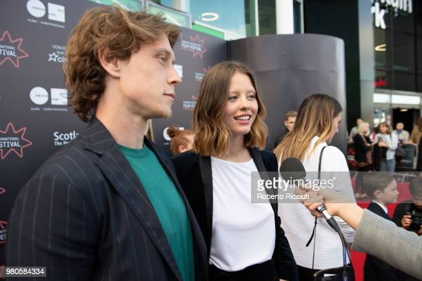 Actors George MacKay and Mia Goth answer to an interview during a photocall for the UK Premiere of 'The Secret of Marrowbone' during the 72nd...