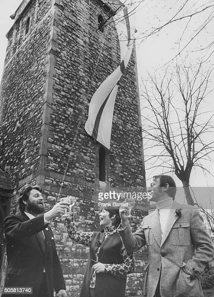 Actors George Murcell Elvi Hale and Christopher Plummer raising the flag of St George as they celebrate the birthday of playwright William...