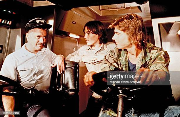 Actors George Peppard Jackie Earle Haley and JanMichael Vincent in a scene from the movie 'Damnation Alley' in 1977