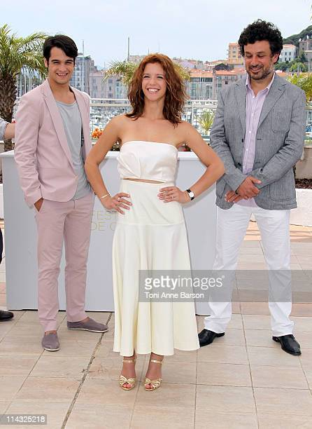 Actors George Pistereanu Ada Condeescu and director Catalin Mitulescu attend the Loverboy Photocall during the 64th Cannes Film Festival at the...