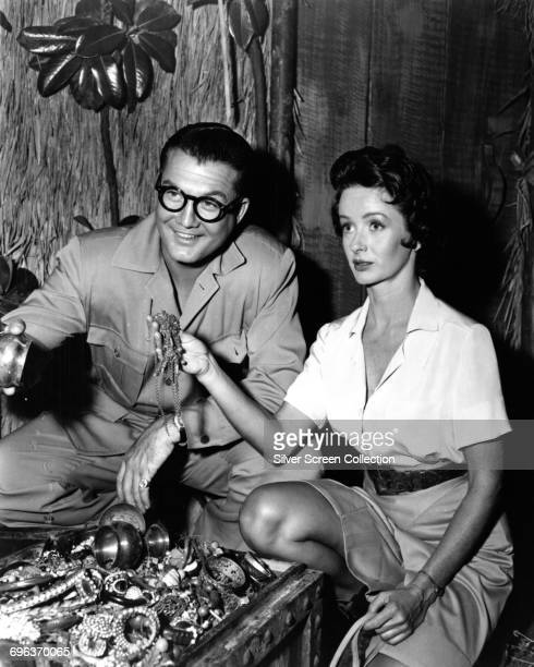Actors George Reeves as Superman/Clark Kent and Noel Neill as Lois Lane finding a treasure chest in the American television series 'Adventures of...