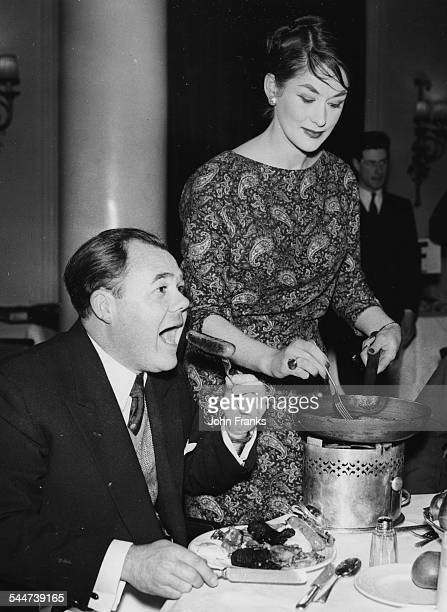 Actors Gerald Campion and Diana Eddington cooking and eating sausages at a Pig Industry Development meeting Waldorf Hotel London February 20th 1959
