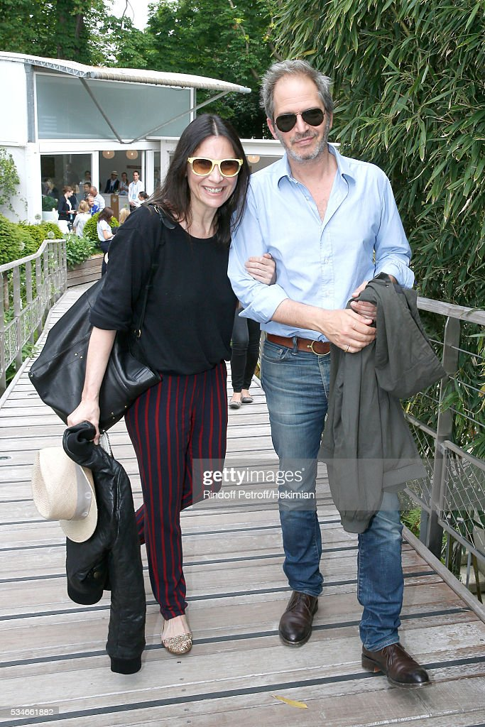 Actors Geraldine Pailhas and Christopher Thompson attend the 2016 French Tennis Open - Day Six at Roland Garros on May 27, 2016 in Paris, France.