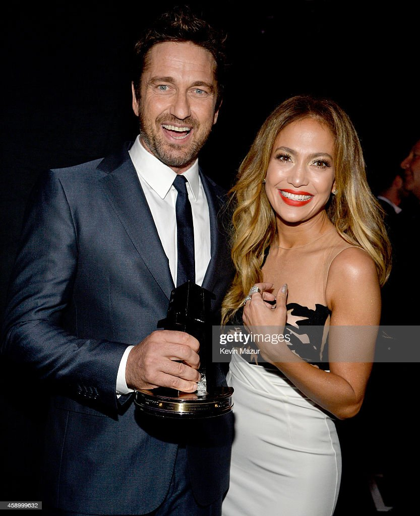 18th annual hollywood film awards backstage and audience photos actors gerard butler l and jennifer lopez pose with the hollywood animation award for ccuart Image collections