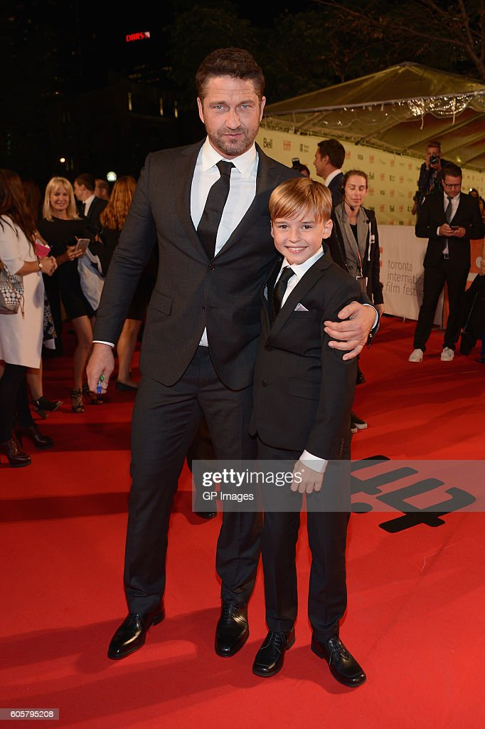 Actors Gerard Butler (L) and Maxwell Jenkins attend 'The Headhunter's Calling' premiere during 2016 Toronto International Film Festival at Roy Thomson Hall on September 14, 2016 in Toronto, Canada.