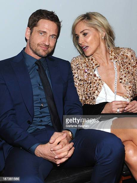 Actors Gerard Butler and Sharon Stone attend the Ermenegildo Zegna Eminences Grises unveiling hosted by Gildo Zegna and Stefano Pilati at JF Chen on...