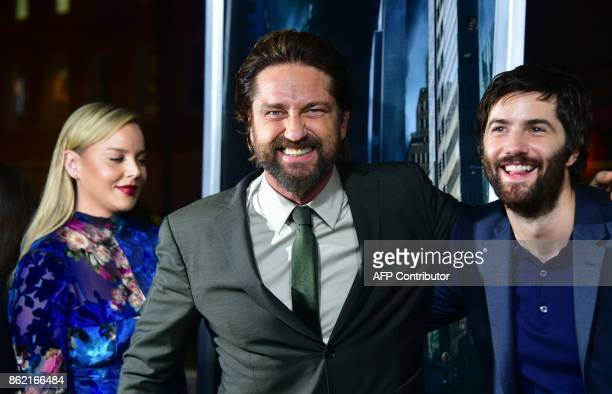 Actors Gerard Butler Jim Sturgess and actress Abbie Cornish arrive for the World Premiere of the film 'Geostorm' in Hollywood California on October...