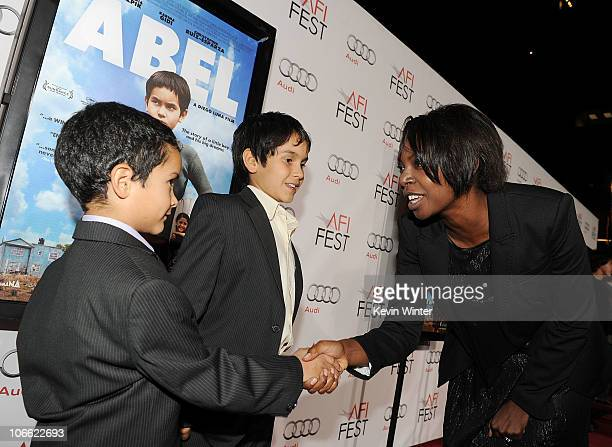 Actors Gerardo RuizEsparza and Christopher RuizEsparza and AFI FEST Director Jacqueline Lyanga arrive at Abel screening during AFI FEST 2010...