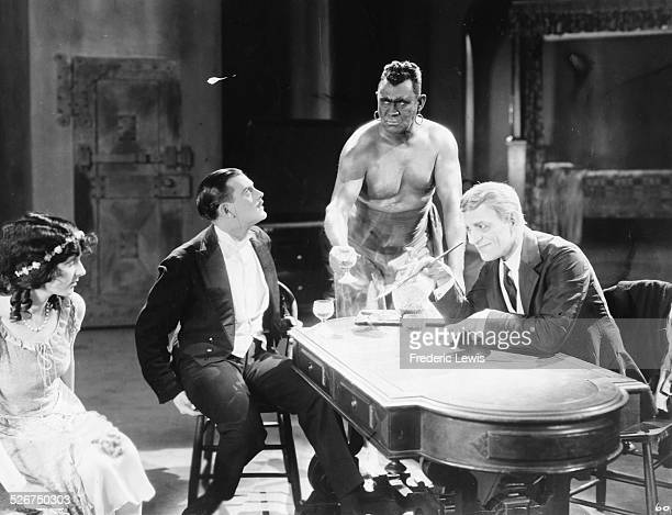 Actors Gertrude Olmstead Hallam Cooley Walter James and Lon Chaney in a scene from the film 'The Monster' 1925