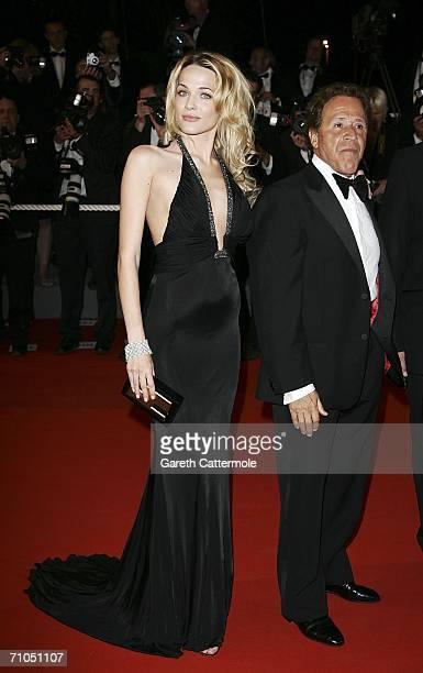 Actors Giacomo Rizzo and Laura Chiatti attends the 'L'Amico Di Famiglia' premiere during the 59th International Cannes Film Festival May 25 2006 in...