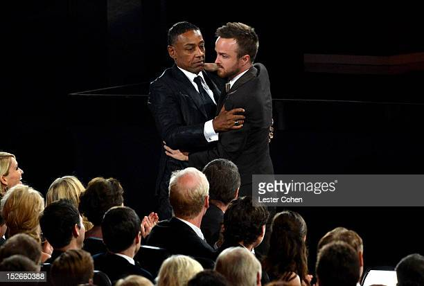 Actors Giancarlo Esposito and Aaron Paul embrace at the 64th Primetime Emmy Awards at Nokia Theatre LA Live on September 23 2012 in Los Angeles...