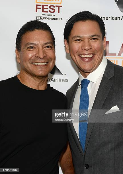 Actors Gil Birmingham and Chaske Spencer arrive at the Winter in the Blood premiere during the 2013 Los Angeles Film Festival at Regal Cinemas LA...
