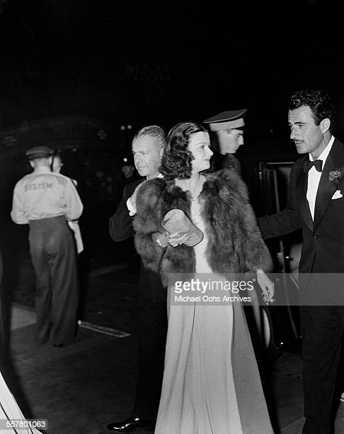 Actors Gilbert Roland and Walter Wanger with actress Joan Bennett attend an event in Los Angeles California