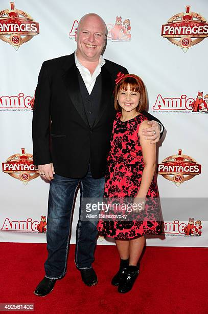 Actors Gilgamesh Taggett and Issie Swickle attend the Premiere of Annie at the Hollywood Pantages Theatre on October 13 2015 in Hollywood California