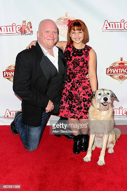 Actors Gilgamesh Taggett Issie Swickle and dog Macy attend the Premiere of Annie at the Hollywood Pantages Theatre on October 13 2015 in Hollywood...