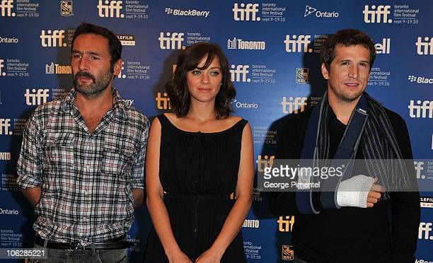 Actors Gilles Lellouche Marion Cotillard and director Guillaume Canet pose at 'Little White Lies' press conference during the 2010 Toronto...