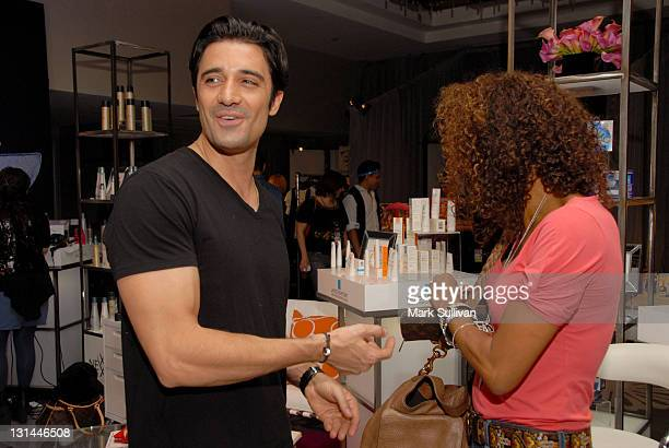 Actors Gilles Marini and Holly Robinson Peete attend the CVS Pharmacy Beauty Club at the Access Hollywood Stuff You Must Lounge produced by On 3...