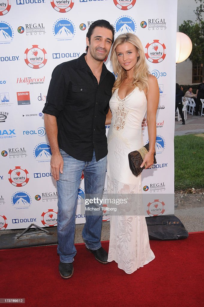 Actors Gilles Marini and Joanna Krupa attend the 3rd Annual Variety Charity Texas Hold 'Em Tournament & Casino Game at Paramount Studios on July 17, 2013 in Hollywood, California.