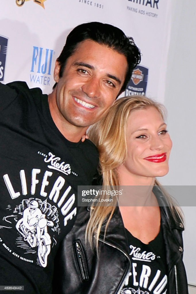 Actors Gilles Marini (L) and Katee Sackhoff attend Kiehl's LifeRide for amfAR co-hosted by FIJI Water on August 12, 2014 in New York City.