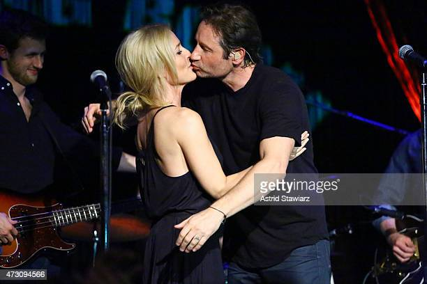Actors Gillian Anderson and David Duchovny attend David Duchovny in concert at The Cutting Room on May 12 2015 in New York City
