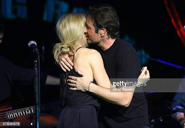Actors Gillian Anderson and David Duchovny attend David Duchovny in concert at The Cutting Room on May 12, 2015 in New York City.