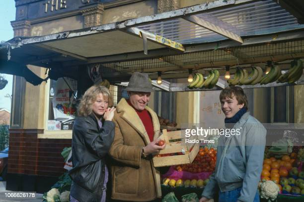 Actors Gillian Taylforth Peter Dean and Adam Woodyatt pictured on the exterior set of the BBC soap opera 'EastEnders' November 21st 1984