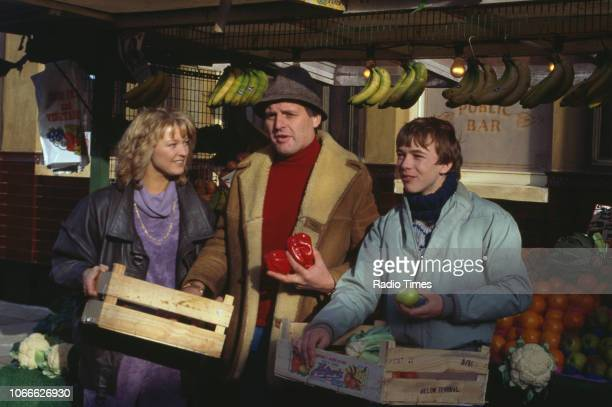 Actors Gillian Taylforth Peter Dean and Adam Woodyatt pictured on the exterior set of the BBC soap opera 'EastEnders' September 26th 1986